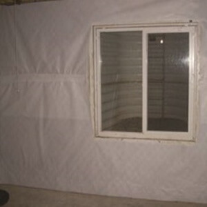 picture of a basement wall liner from Resch Enterprises on a basement wall with a window